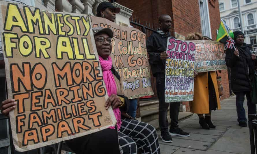 Protesters against deportation flights at the Jamaican embassy in London on 3 February.