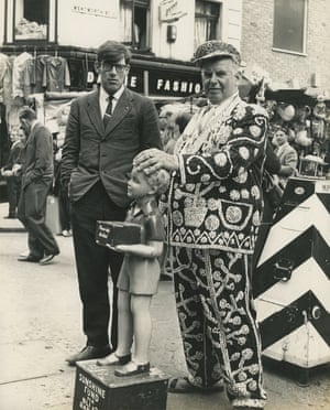 A pearly king at Petticoat Lane market in London, 1960s