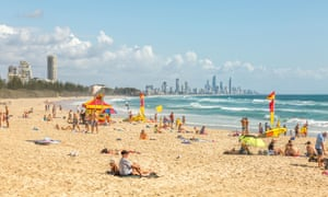 High rise apartment buildings at Surfers Paradise with Burleigh head beach in the foreground, Gold Coast, Queensland, Australia