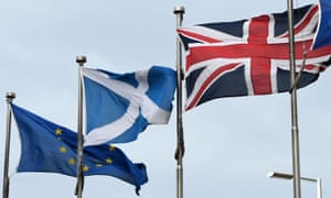 A Scottish saltire, a union flag and an EU flag.