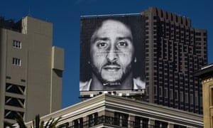 Large Nike poster of Colin Kaepernick on a rooftop