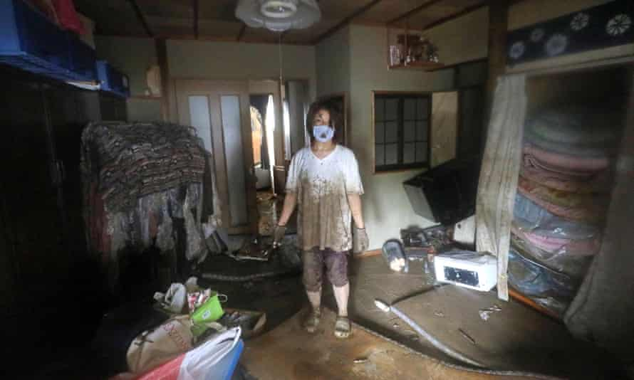 A local resident cleans her house hit by floods in Hitoyoshi, Kumamoto prefecture