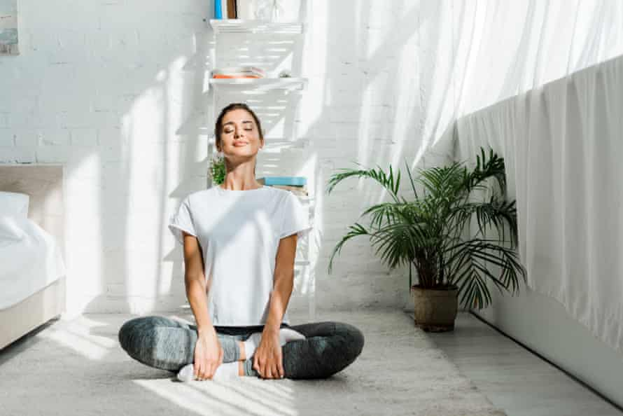 Get to know your cycle and you'll know when a yoga day is most beneficial (posed by model).