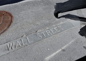 A Wall Street sign in a sidewalk near the New York Stock Exchange.