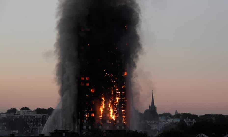 Flames and smoke billow from Grenfell Tower on the morning of 14 June.