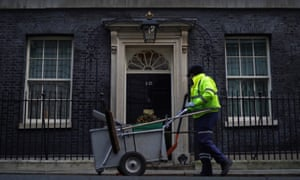 A cleaner working outside 10 Downing Street.