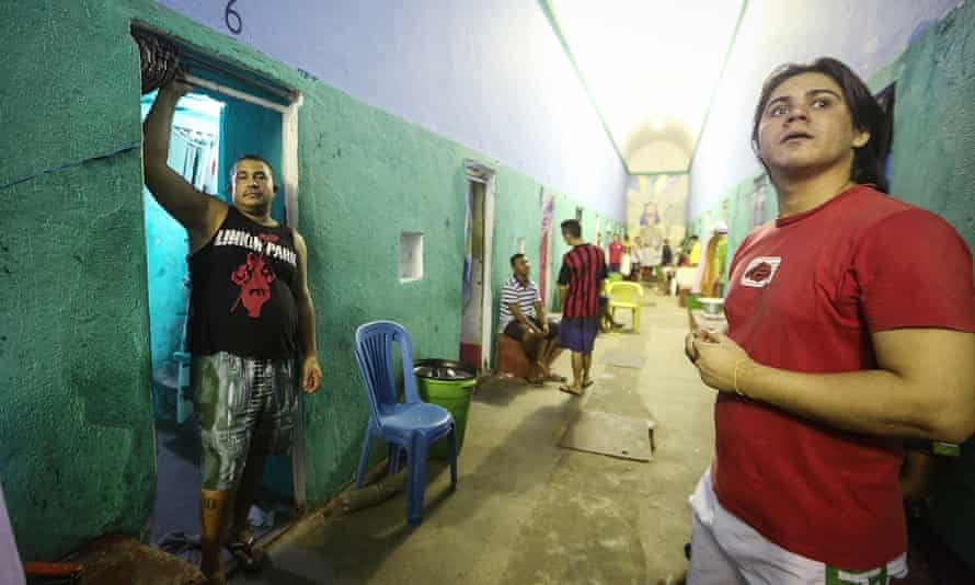 Detainees stand in a hallway of the overcrowded Desembargador Raimundo Vidal Pessoa penitentiary in Manaus. The prison dates from 1904.