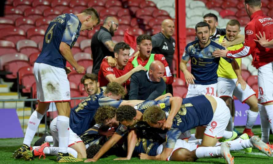 Clarke Oduor is mobbed by teammates last July as Barnsley pull off a remarkable escape to stay in the Championship – again.