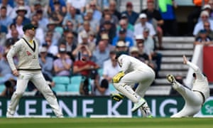 Joe Root of England is dropped by Australia's wicketkeeper Tim Paine (centre).
