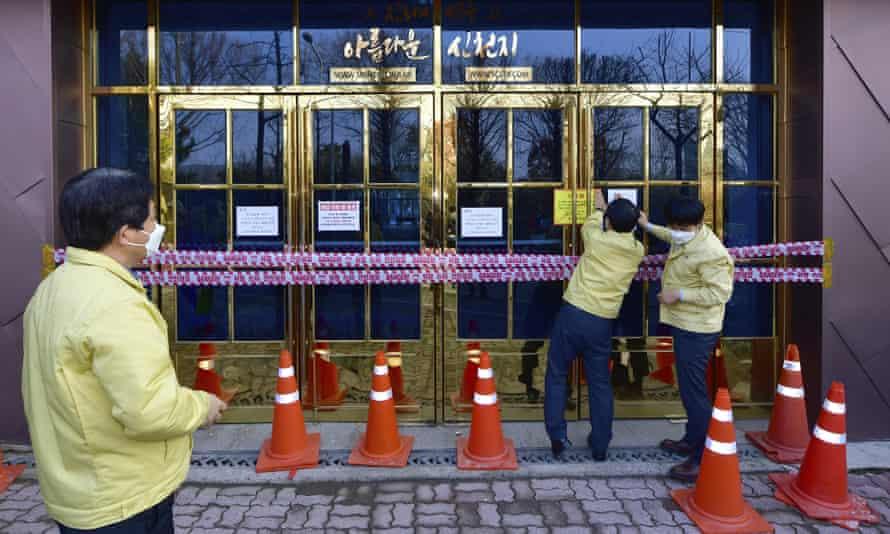 Government officials close down a branch of the Shincheonji Church of Jesus in Gwangju, South Korea