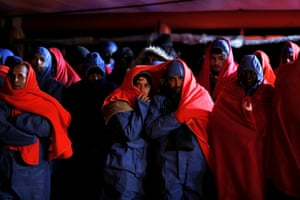 Malaga, Spain: Migrants wait to disembark from a rescue boat.