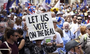 A demonstrator holds a banner during a London march calling for a second referendum on the final Brexit deal.