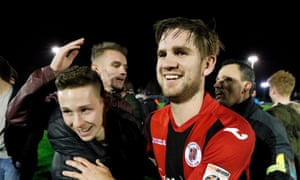 Brackley Town's Jimmy Armson celebrates after the match with fans of the Northamptonshire club