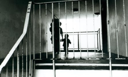 Silhouette of a mother with her children in the hallway of a block of flats