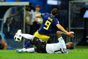 Germany's Jerome Boateng fouls Sweden's Marcus Berg.