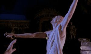 Peter Garrett holding a microphone
