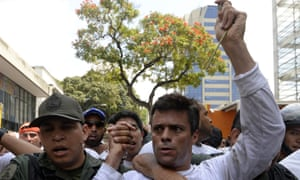 Leopoldo López is escorted by the national guard after turning himself in during a demonstration in Caracas on 18 February 2014.
