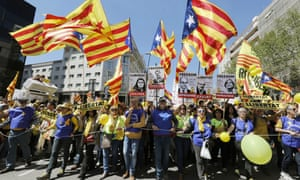 Thousands of marchers wave pro-Catalan independence flags during a protest in Barcelona