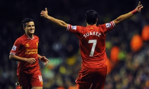 Philippe Coutinho runs to Luis Suárez to celebrate a goal at Anfield during their time together at Liverpool.