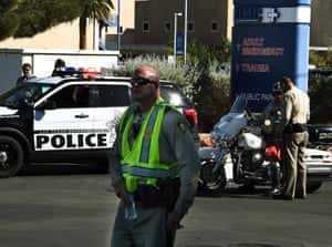 Police keep watch outside the trauma department at the University Medical Center in Las Vegas