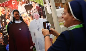 A nun snaps her friend next to a cardboard cut-out of the pope at last year's World Congress of Families in Dublin.