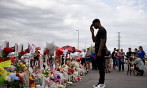 Anthony Emanuel salutes to victims of the El Paso shooting at a memorial in El Paso, Texas, 6 August 2019.