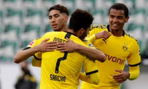 Achraf Hakimi celebrates with Jadon Sancho and Manuel Akanji after doubling Dortmund's lead