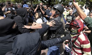 Anti and pro-Donald Trump supporters clash at Martin Luther King Jr Civic Center Park in Berkeley, California on Saturday.