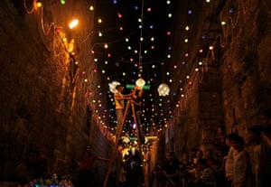 Palestinians decorate an alley of Jerusalem's old city with lights in preparation for the Muslim holy month of Ramadan.