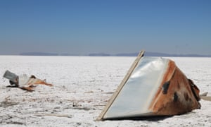 A boat lies on its side on the salt flat that used to be Lake Poopó.