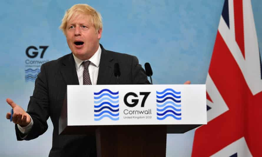 Boris Johnson gestures during a press conference on the final day of the G7 summit