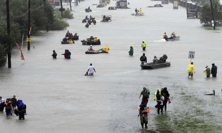 Rescue boats fill a flooded street in Houston after tropical storm Harvey.