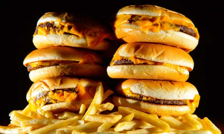 A stack of burgers and salty chips