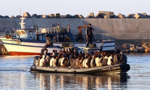 Sub-Saharan African migrants are rescued by the Libyan coastguard after their inflatable boat started to sink off Garabulli.