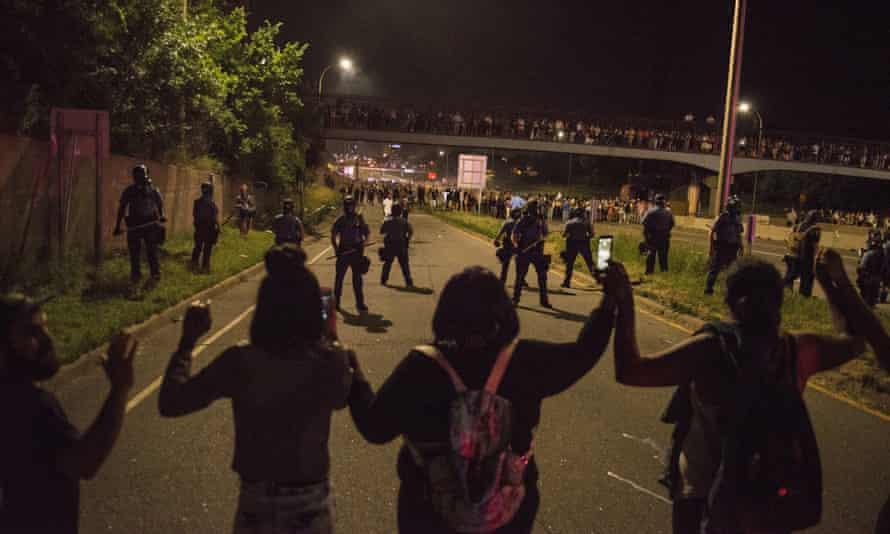 Protestors link hands on shut down highway I-94 on July 9, 2016 in St. Paul, Minnesota.