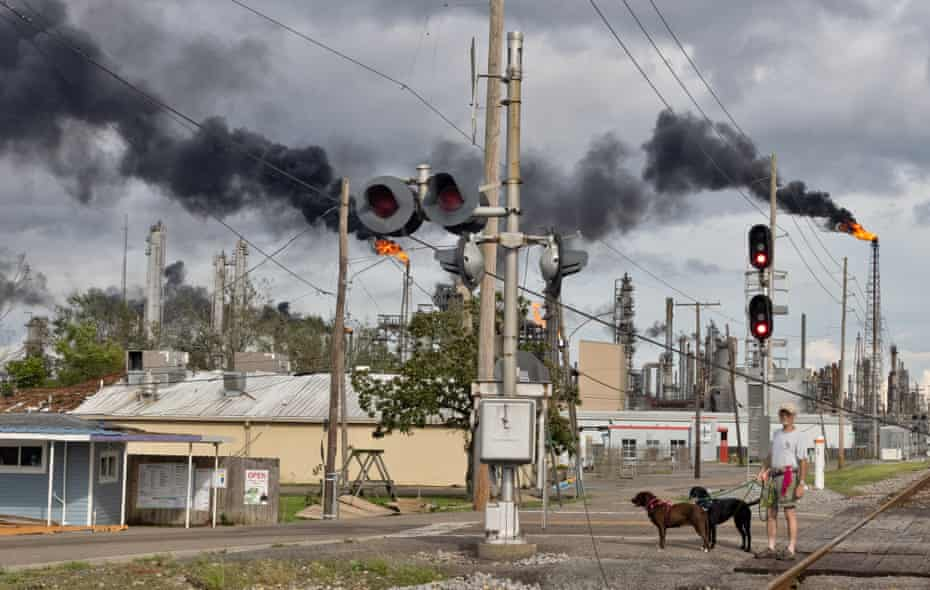 Peter Anderson walks his rescue dogs, Phoebe and Joe, near the Shell Norco manufacturing complex.
