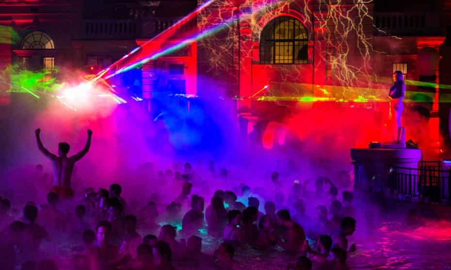 People in the pool with disco lights at a Sparty event at Széchenyi bath, Budapest.