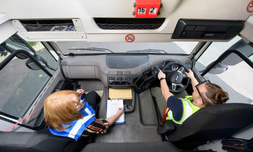 Jo Markham, transport Manager for the logistics company Wincanton takes HGV1 driver Gabi Stefan through a refresher course in vehicle checks and yard positioning at their Portbury depot near Bristol.