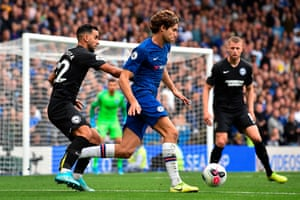 Chelsea's Marcos Alonso runs with the ball.