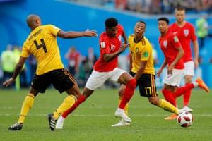 Marcus Rashford cuts between two Belgian players.