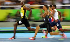 Usain Bolt of Jamaica leads the field in the 100 metres at the 2016 Rio Olympics.