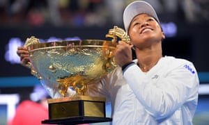 Naomi Osaka of Japan poses with the China Open trophy after winning the final against Ash Barty in Beijing.