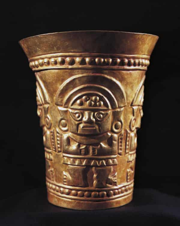 A gold vase decorated with the figure of Naymlap, first king of Lambayeque.