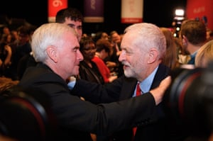 Jeremy Corbyn (R) embraces shadow chancellor, John McDonnell, after being re-elected leader of the Labour party.
