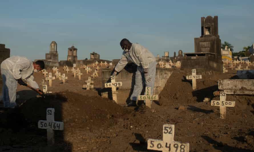 People bury coronavirus victims in Rio de Janeiro.