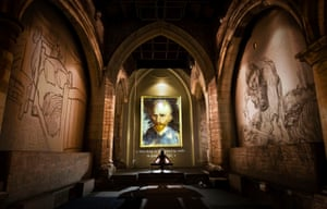 A woman views the exhibition Van Gogh: the Immersive Experience at St Mary's church in York, UK