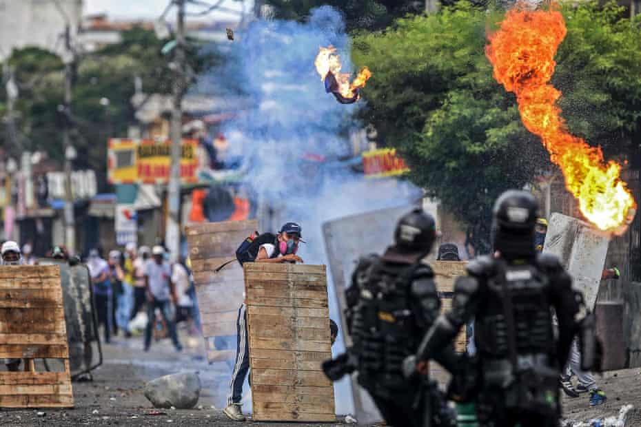 Protesters and riot police clash in Cali, Colombia, on April 29.