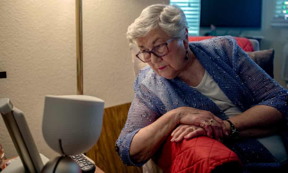 Juanita Erickson, 93, and ElliQ, her robot companion, in her studio apartment in Carlton Senior Living in the San Francisco Bay Area.