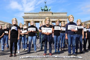 Berlin, Germany Protesters wear masks with the image of Julia Klöckner, minister for food, agriculture and consumer protection, during a demonstration for future-proof EU agricultural reform, near the Brandenburg Gate