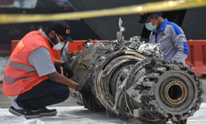 Investigators check debris of the Lion Air plane that crashed off Jakarta on 29 October.